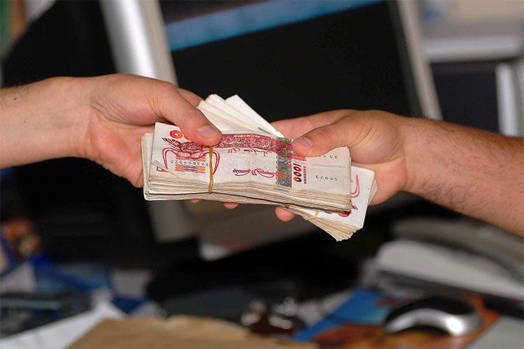 حكم تسديد القروض بفائدة